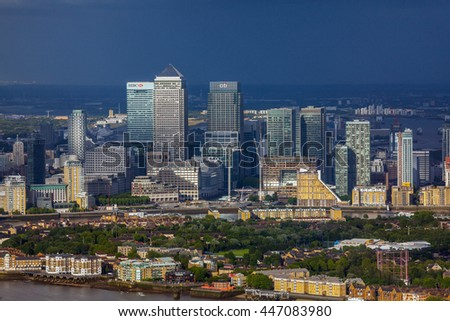 LONDON, UK - JULY 2: Rainy weather over the Business Centre Canary Wharf in London, photo taken from 72nd floor of The Shard on July 2nd, 2016 - stock photo