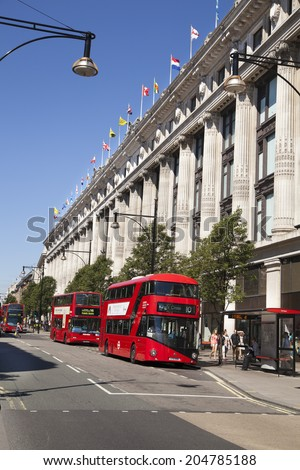 LONDON, UK - JULY 03, 2014: Selfridges superstore on Oxford street,  shopping mail with famous fashion boutiques and big stores - stock photo