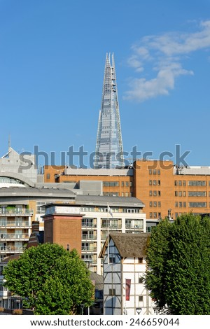 LONDON, UK - JULY 1, 2014: Shard skyscraper designed by the Italian architect Renzo Piano, seen from the Globe, has 87 storeys over a height of 1004 feet. The Shard is the tallest building in Europe.  - stock photo