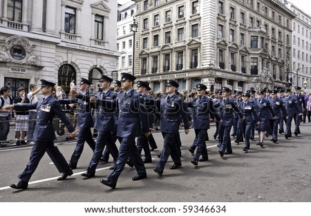 LONDON, UK - JULY 3: The Gay Pride Parade Passes Through Picadilly in London, RAF Personnel March Past The Crowds July 3, 2010 in London, UK - stock photo