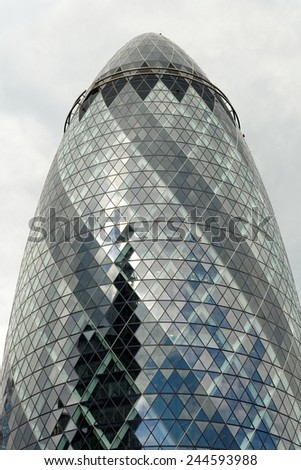 LONDON, UK - JULY 1, 2014: The modern 30 St Mary Axe, called Swiss Re Building or informally the Gherkin  in the City of London, one of the leading centers of global finance.  - stock photo