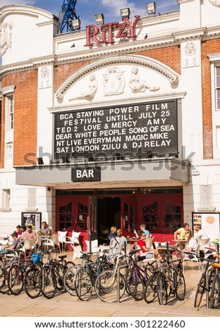 """London, UK - 11 July 2015: The Ritzy is a famous cinema in Brixton, South London. The cinema opened on 11 March 1911 as """"the Electric Pavilion"""". In 2009 a live music venue was added, called Upstairs. - stock photo"""