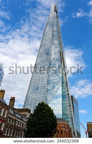 LONDON, UK - JULY 1, 2014: The Shard skyscraper designed by the Italian architect Renzo Piano has 87 storeys over a height of 1004 feet. The Shard is the tallest building in Europe. - stock photo
