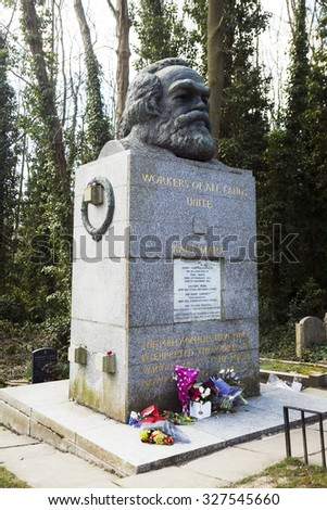 LONDON, UK - JULY 6, 2013: Tomb and Statue of Philosopher Karl Marx, marking his resting place in Highgate Cemetery, London. - stock photo