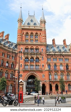 LONDON, UK - JULY 9, 2014: Tourists admire the architecture of the St. Pancras Renaissance hotel in London - stock photo