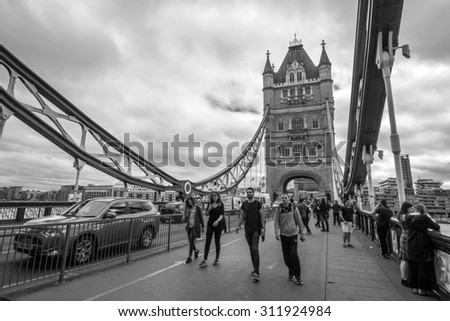 LONDON, UK - JULY 22, 2015: Tower Bridge is a combined bascule and suspension bridge in London. The bridge crosses the River Thames and has become an iconic symbol of London. - stock photo