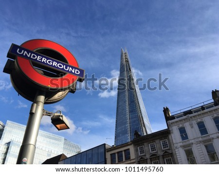 LONDON,UK-2 JUN 2017: Underground  signboard under blue sky with The Shard building background.