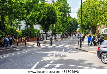 LONDON, UK - JUNE 10, 2015: Abbey Road zebra crossing made famous by the 1969 Beatles album cover (HDR)