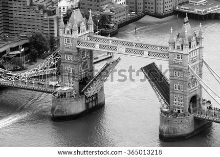 LONDON, UK - JUNE 10, 2015: Aerial view of Tower Bridge over River Thames - stock photo