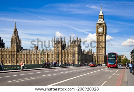 LONDON, UK - JUNE24, 2014 - Big Ben and Houses of Parliament on Thames river  - stock photo