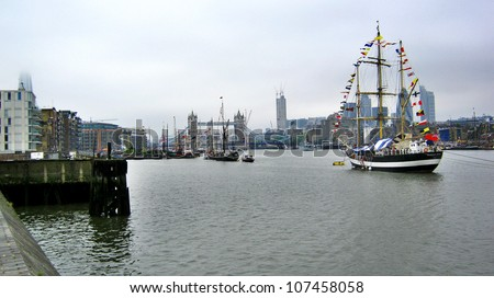 LONDON, UK-JUNE 1: Boats decorated with flags and bunting for the Queen's Diamond Jubilee celebrations, with the Tower Bridge in background. June 1, 2012 in London UK - stock photo