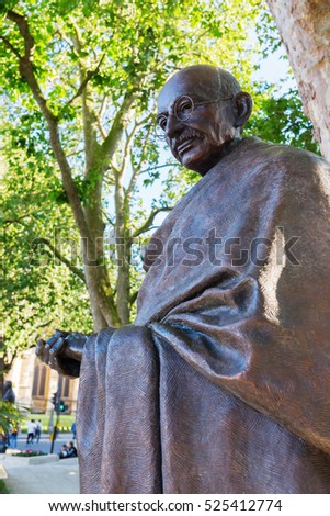London, UK - June 20, 2016: bronze statue of Mahatma Gandhi in London. Gandhi led India to independence and inspired movements for civil rights and freedom across the world.