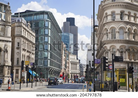 LONDON, UK - JUNE 30, 2014: Busy city of London street, leading to the Bank of England  - stock photo