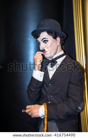 LONDON , UK - JUNE 7, 2015:   Charlie Chaplin, the actor, wax figure in  Madame Tussauds museum