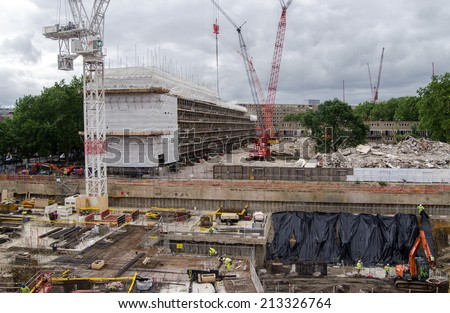 LONDON, UK  JUNE 16, 2014:  Construction work at the former Heygate Estate in Southwark, South London.  The council housing estate was notorious for crime and antisocial behaviour. - stock photo