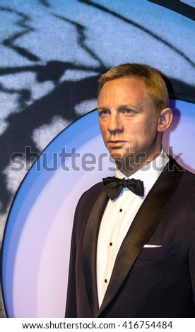 LONDON , UK - JUNE 7, 2015:  Daniel Craig as the agent 007 James Bond in Madame Tussauds museum in London. Marie Tussaud was born as Marie Grosholtz in 1761 - stock photo