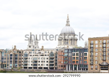 LONDON, UK - JUNE 23: Dome of Saint Paul's cathedral surrounded by lower buildings, seen from Blackfriars. June 23, 2015 in London. - stock photo