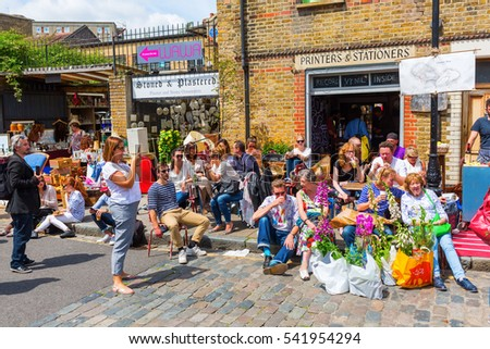 London, UK - June 15, 2016: flea market in a byroad of the famous Columbia Road Flower Market in London, with unidentified people.