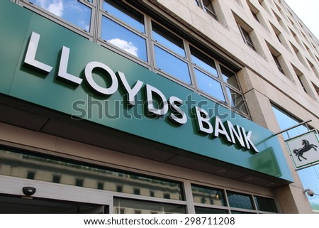 LONDON, UK - JUNE 16, 2015:: Lloyds Bank branch with sign and logo. Lloyds Bank plc is a British retail and commercial bank with branches across England and Wales - stock photo