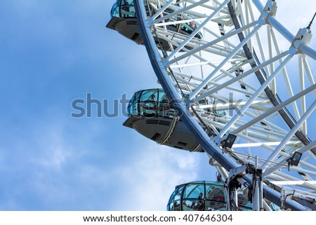 LONDON, UK - JUNE 6, 2015: Moving  a giant Ferris wheel situated on the banks of the River Thames - stock photo