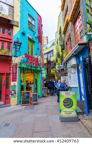 London, UK - June 16, 2016: Neals Yard with unidentifed people. It is a small alley in Covent Garden with colorful houses. It contains several health food cafes and values driven retailers