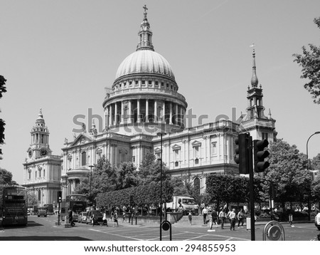 LONDON, UK - JUNE 11, 2015: People in front of St Paul Cathedral church in black and white