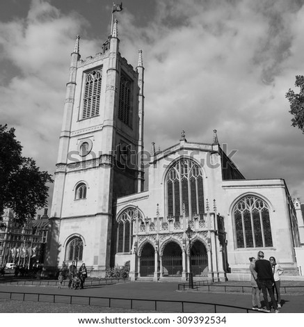LONDON, UK - JUNE 09, 2015: People visiting St Margaret Church at Westminster Abbey in black and white - stock photo