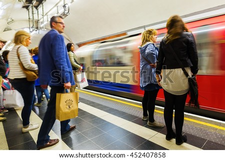 London, UK - June 18, 2016: platform of an underground station with unidentified people in London. The London Underground is the oldest underground of the world. - stock photo
