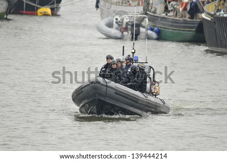 LONDON, UK-JUNE 1: Police boats watching on Thames river during the Queen's Diamond Jubilee celebrations on June 1, 2012 in London England, UK - stock photo