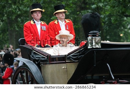LONDON, UK - JUNE 13: Queen Elizabeth and Duke of Edinburgh appear during Trooping the Colour ceremony, on June 13, 2015 in London, England, UK - stock photo