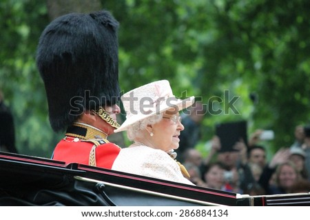 LONDON, UK - JUNE 13: Queen Elizabeth appears during Trooping the Colour ceremony with Prince Phillip, on June 13, 2015 in London, England, UK - stock photo