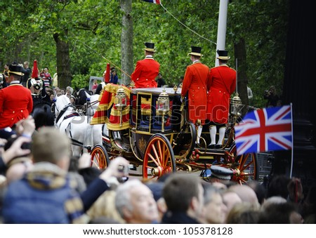 LONDON, UK - JUNE 16: Queen Elizabeth II and the Duke of Edinburgh during Trooping the Colour ceremony on the Mall and at Buckingham Palace, on June 16, 2012 in London. - stock photo