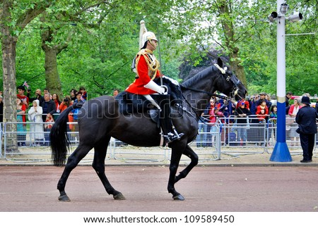 LONDON, UK - JUNE 02: Queen's guards during Trooping the Color ceremony parade on the Mall and at Buckingham Palace, on June 02, 2012 in London. - stock photo