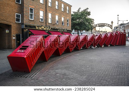 LONDON, UK - JUNE 4, 2013: Sculpture by David Mach was commissioned in 1988 as part of the landscaping for the new Relief Road, and is called Out of Order. Kingston upon Thames, London. - stock photo