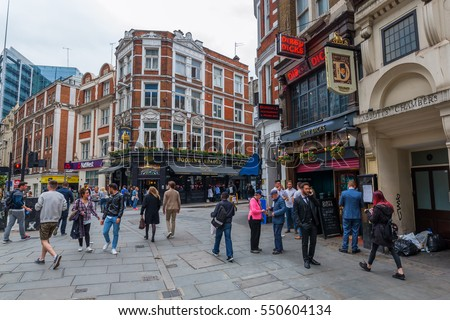 London, UK - June 18, 2016: street view at Bishopsgate in the City of London with unidentified people. The City of London is a county in London. There is the major business and financial centre.