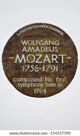 LONDON, UK - JUNE 4TH 2013: A plaque in London marking the place where Wolfgang Amadeus Mozart composed his first symphony.  Taken in Belgravia, London on 4th June 2013. - stock photo