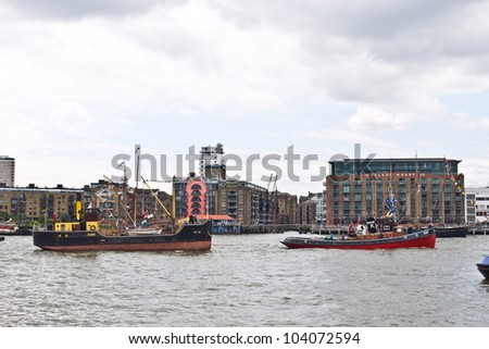 LONDON, UK-JUNE 1: The Kent  a tug boat built in 1948 with Vic 56 a coastal steamer that supplied the Navy in World War II ready for the Queen's Diamond Jubilee Pageant. June 1, 2012 in London UK - stock photo
