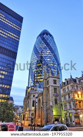 LONDON, UK- JUNE 06: The modern glass buildings of the Swiss Re Gherkin on Julne 06, 2014 in London, England. This tower is 180 meters tall and stands in the City of London Financial District. - stock photo