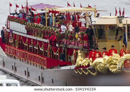 LONDON, UK - JUNE 03: The Royal family on board 'Spirit of Chartwell' during the queens Jubilee Pagent on the June 03, 2012 in London, UK - stock photo