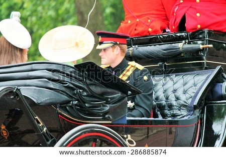 LONDON, UK - JUNE 13 2015: The Royal Family Prince Harry appears during Trooping the Colour ceremony sharing carriage with Catherine Duchess of Cambridge and Camilla, in London, England, UK - stock photo