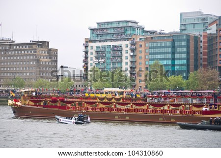 LONDON, UK-JUNE 3: The Spirit of Chartwell the Royal Barge carries the Queen and Royal family in the 1000 strong flotilla in the Diamond Jubilee Pageant on the River Thames.June 3, 2012 in London UK. - stock photo