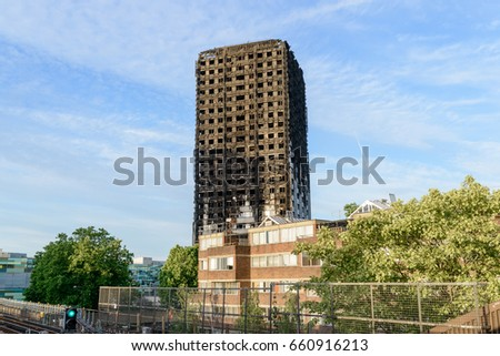 London, UK - June 15 2017: The 24-storey Grenfell Tower, a block of public housing flats in North Kensington, London, England one day after the fire that occurred on 14 June 2017.