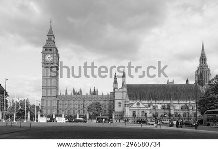 LONDON, UK - JUNE 09, 2015: Tourists in Parliament Square in Westminster in black and white - stock photo