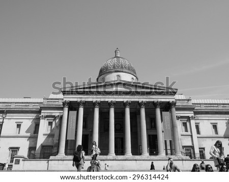 LONDON, UK - JUNE 11, 2015: Tourists visiting Trafalgar Square in front of the National Gallery in black and white
