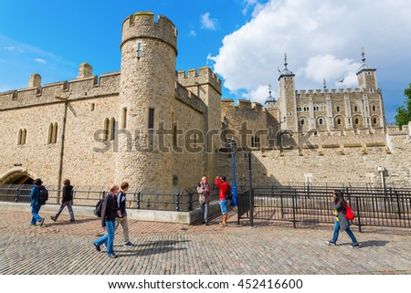 London, UK - June 15, 2016: Tower of London with unidentified people. The Tower of London is one of the countrys most popular tourist attractions, protected as a World Heritage Site.