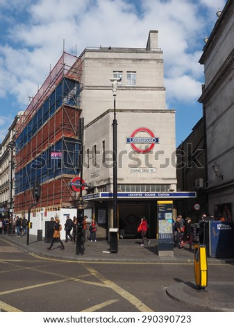 LONDON, UK - JUNE 10, 2015: Travellers at Leicester Square underground station