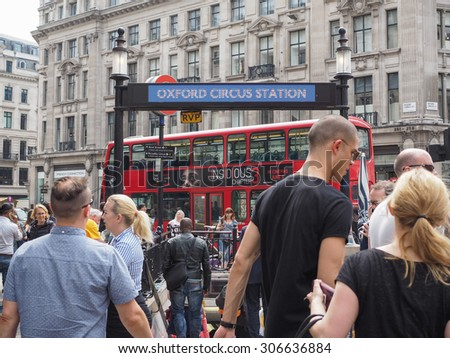 LONDON, UK - JUNE 12, 2015: Travellers at Oxford Circus underground station - stock photo