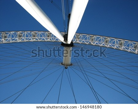 LONDON, UK - JUNE 26: Under London Eye, detail of construction on June 26, 2011 in London, UK. The rim of the Eye is supported by tensioned steel cables and resembles a huge spoked bicycle wheel.  - stock photo