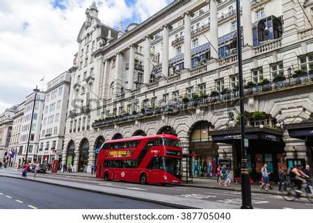 LONDON, UK - JUNE 6 , 2015: Unidentified people and traffic in Piccadilly street . The city is visited by more than 30 million people every year.