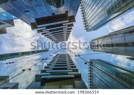LONDON, UK - JUNE 08, 2014: Upward view of  modern skyscrapers in the City of London, UK. The City is a major business and financial centre. Over 300,000 people commute to and work there. - stock photo